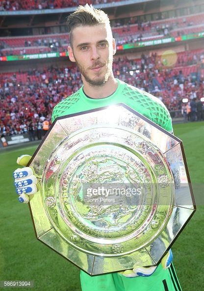 David de Gea of Manchester United poses with the Community Shield trophy after…