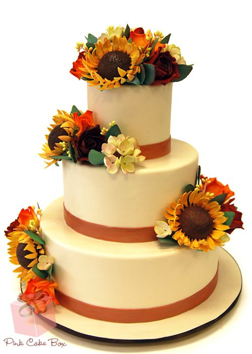 Rustic Themed Sunflower Wedding Cake by Pink Cake Box in Denville, NJ.  More photos and videos at http://blog.pinkcakebox.com/rustic-themed-wedding-cake-2010-09-27.htm