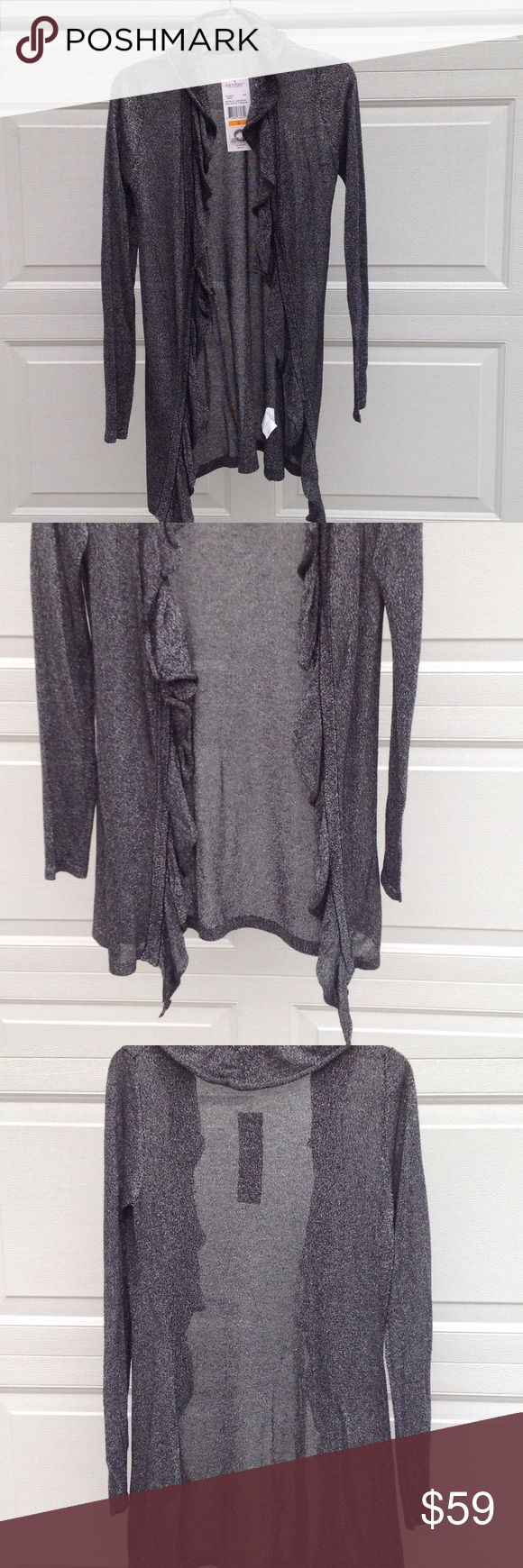 NWT KAREN KANE METALLIC SWEATER This is a sparkly black and silver cardigan. It's in perfect condition with no picks or snags. It has hook closure about half way down. It is made of rayon and polyester. Looks sexy with jeans or great with something dressy. Karen Kane Sweaters Cardigans