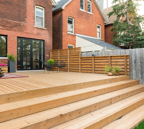 The deck extends  into the yard with wide steps that double as great seating for outdoor gatherings. #design #interiors #interiordesign  #designinspiration #inspiration #decor #homes