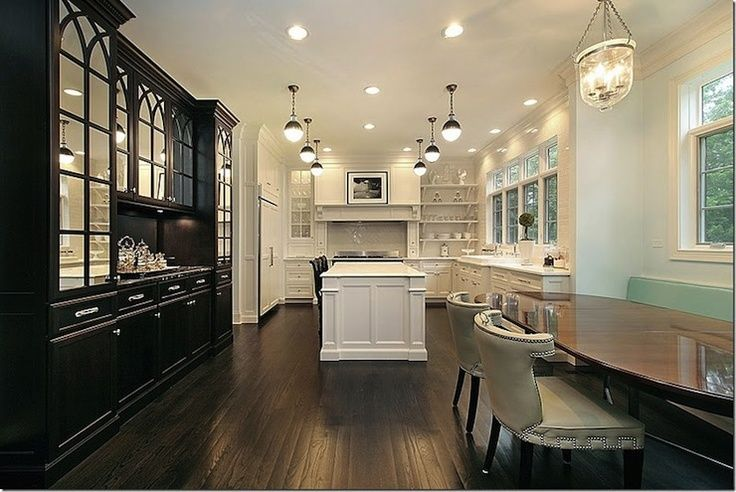 The six lights that are illuminating the kitchen in this picture.  This is what I am trying to find.  I will have small cans around the perimeter of the kitchen.  I am looking for something to hand in the middle for interest.
