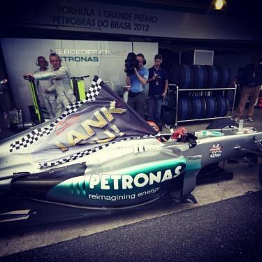 "Michael and his ""Thank You"" flag before the race yesterday #dankemi...    via - twitter | @MercedesAMGF1"