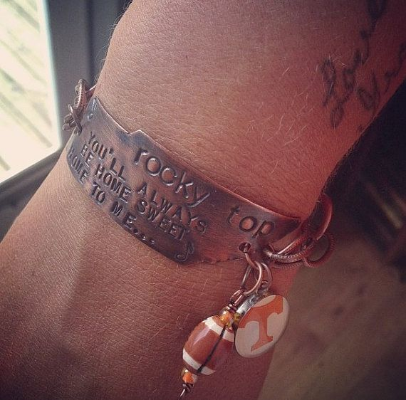 I hand cut the state from copper , hand stamp the lyrics to Rocky Top on it and give it a nice antique look - a Power T (NOTE - the power T charms