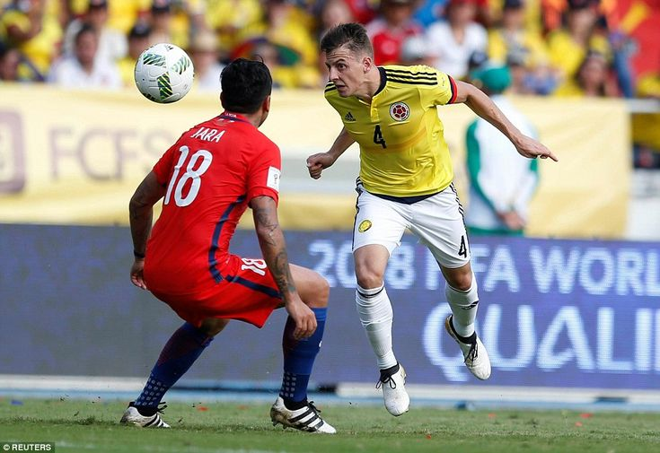 Colombia's Arias heads the ball past Gonzala Jara as teams battled for a point in pursuit of World Cup qualification