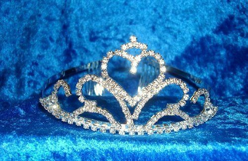 Crystal Sparkled Heart on a wave-designed Rhinestone Bridal Tiara AMTL-1132 by AM Gem Street. $18.49. This dramatic bridal tiara features an elegant heart on wave-designed set with sparkling rhinestones. A wonderful headpiece for your bridal party, it includes combs on both sides of the headband for an easier attachment. This sensational bridal tiara has a medium yet comfortable wearing weight. Quality materials are used to create a beautiful piece.