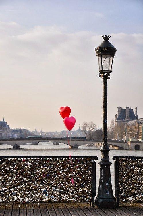 Pont des arts bridge. Red heart balloons.