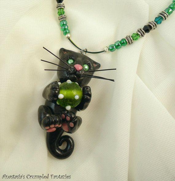 Polymer clay black kitty necklace by CrumpledFantazies