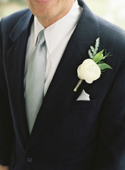 Ranunculus boutonniere: http://www.stylemepretty.com/2015/02/16/traditional-charleston-plantation-wedding/ | Photography: Virgil Bunao - http://virgilbunao.com/