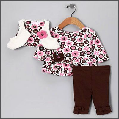 Floral Princess 3 Piece. Perfect for your floral princess! This 3 piece set features a floral print long sleeve shirt with flower and button appliques. With a white attached shrug and matching brown leggings, she'll definitely be the centre of attention!