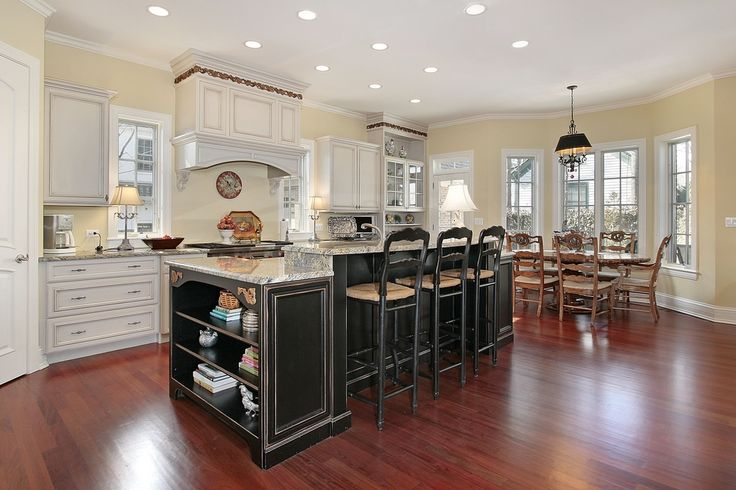 I like the island and sink that is directly in front of the stove plus the open cabinet/books shelf at the end