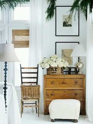 love the contrasts   white, natural wood, rattan, black   silvery merc glass   greens