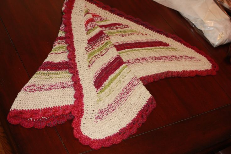 several different colors and a unique border on simple traingle shawl