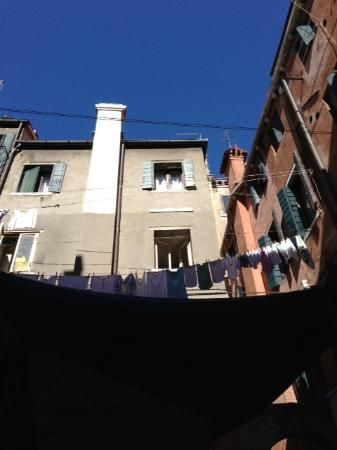 View from our seats in the little back cove patio...laundry? La Gondola  |  Centro Storico calle