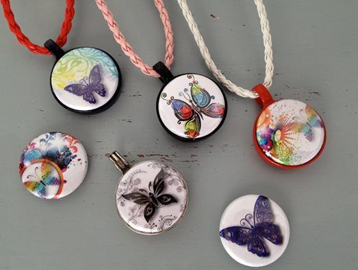 Butterfly range of pendants, necklaces and buttons.