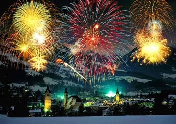 """""""Kitzbühel, Austria.  One of the world's more unusual New? Year's destinations, Kitzbühel celebrates on New Year's Day when instructors from the Rote Teufel ski school light their poles and entertain thousands with a daredevil ski show on the Hahnenkamm downhill race course."""