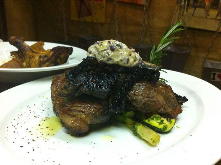Bombay Bicycle Club 300g of juicy organic rump topped with black mushroom,marinated greens finished in red wine butter  #Capetown #Kloof
