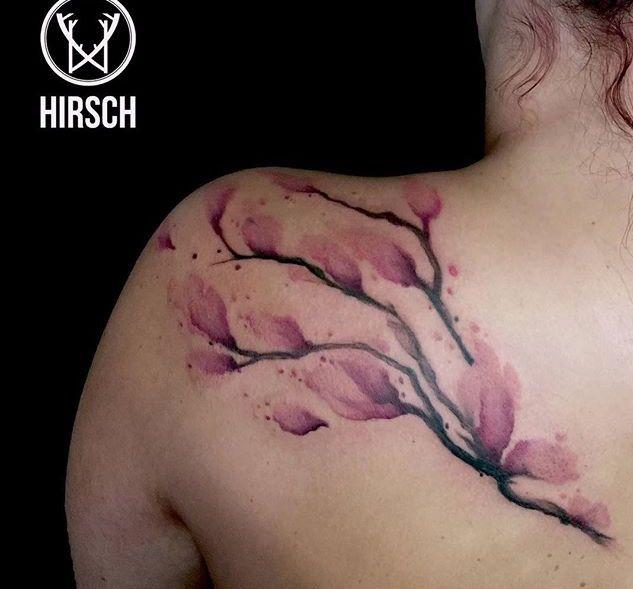 Tatuaggio ramo con fiori watercolor