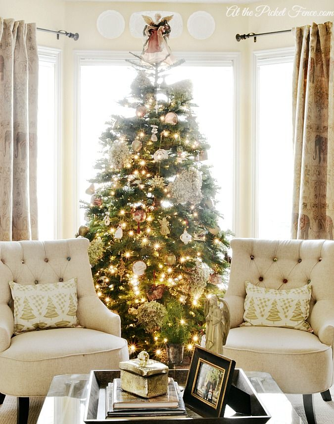 Love the chairs! living room Christmas tree in bay window from atthepicketfence.com - swoon worthy!