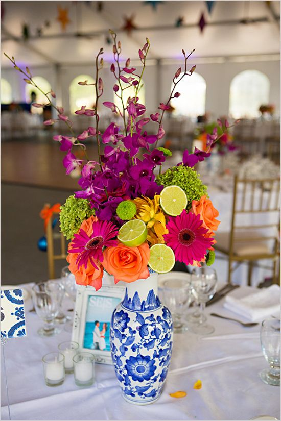 I love this vase! Beautiful festive florals http://www.weddingchicks.com/2013/01/29/fiesta-inspired-wedding/#Contest