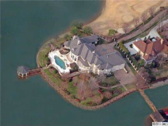 Michael Jordan's newest North Carolina home is perfectly perched on the seventh hole of the Peninsula Golf Club.