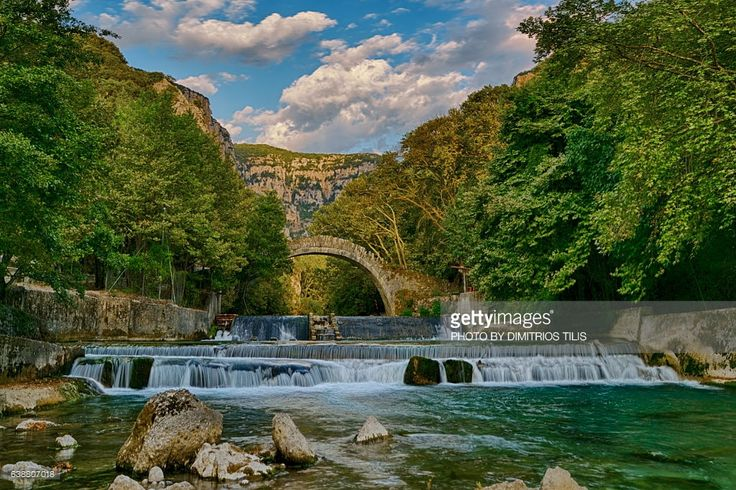 Klidhonia's stone bridge above Voidomatis river from where begins Vikos gorge