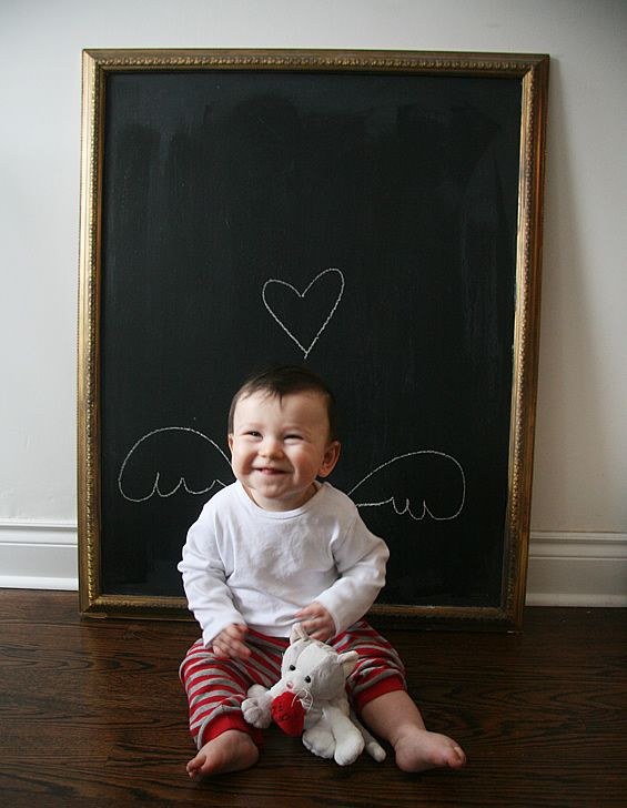 Cute idea for baby photos using a chalkboard. Maybe Valentine's Day, etc.
