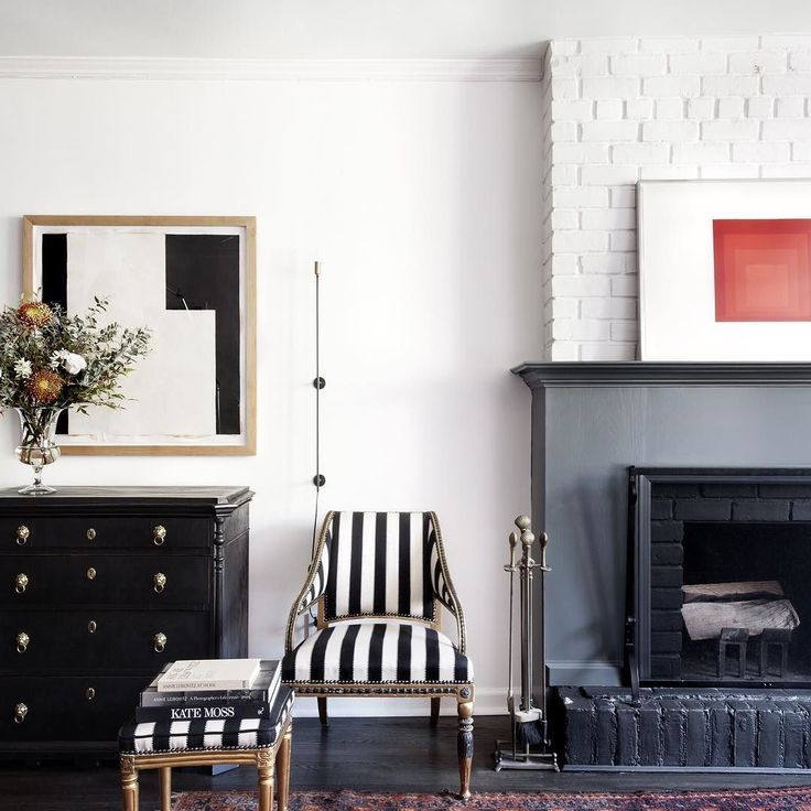 Monochrome Hallway With Black And White Chair Open Fireplace And Artwork Hanging On The W Scandinavian Design House Modern Scandinavian Design Interior Design