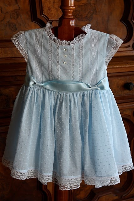 """What a beautiful dress!  - Pattern:  The Bodice Dress by Collars, Etc. Pattern Company.  Fabric:  Bear Threads blue hailspot voile for dress; blue swiss voile for slip.  Laces:  Bear Threads' french malines - 3/8"""" beading, 1/2"""" insertion, 1 1/8"""" insertion, 5/8"""" edging, 1"""" edging; Capitol Imports' white baby entredeaux."""