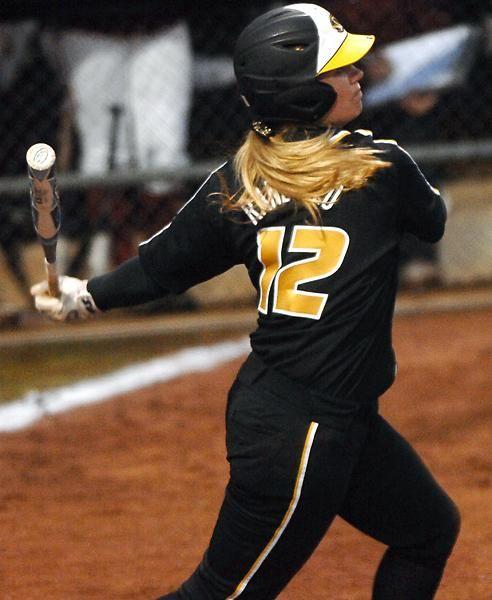 teen-girls-wearing-softball-uniforms
