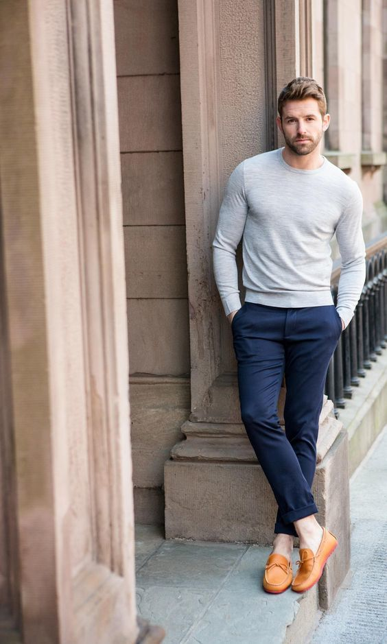 This combination of a grey crew-neck pullover and deep blue chino pants is perfect for off-duty occasions. Round off this look with orange leather moccasins. Shop this look on Lookastic: https://lookastic.com/men/looks/grey-crew-neck-sweater-navy-chinos-orange-leather-driving-shoes/20909 — Grey Crew-neck Sweater — Navy Chinos — Orange Leather Driving Shoes
