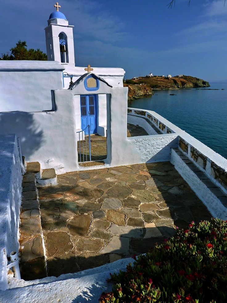 Coastal church and paved courtyard overlooking the sea in Stavros, Tinos island, Cyclades, Aegean_ Greece