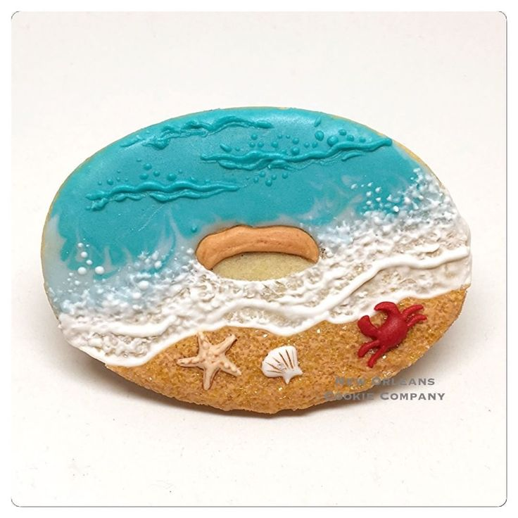 "50 Likes, 10 Comments - New Orleans Cookie Company (@neworleanscookiecompany) on Instagram: ""Wait......Is that a BEACH donut?? Oh yeah baby!! ⚜️ Happy National Donut Day!! ⚜️Decorated Sugar…"""