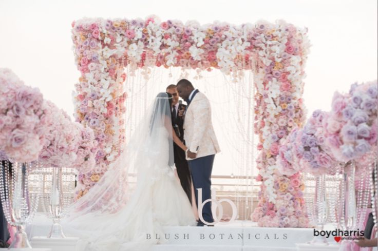 WAGS Miami star marries Corey Liuget of the Chargers in this glamorous pink and pastel San Diego wedding by Blush Botanicals, Details Defined, Hire Elegance.  Pink Wedding, over the top wedding, flower chandelier, chuppah, flower canopy.  Flower canopy wedding ceremony  photo: Boyd Harris