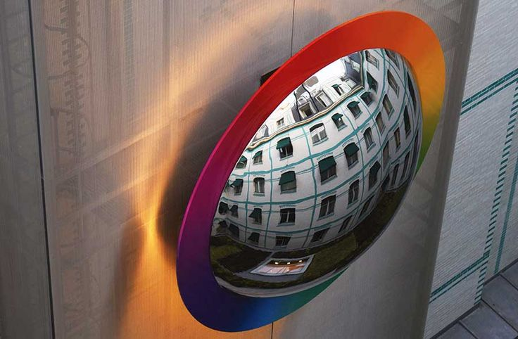Reflections in a wall sculpture at the Peninsula Hotel, Paris, France