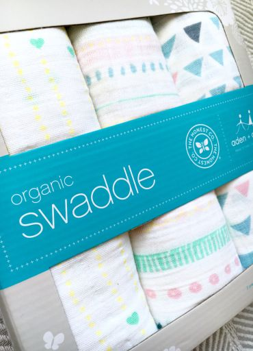 Baby update: week 33. Baby gear, packing the hospital and diaper bag. Love these incredibly soft swaddling blankets from the Honest Co. and Aden + Anais in the adorable tribal prints