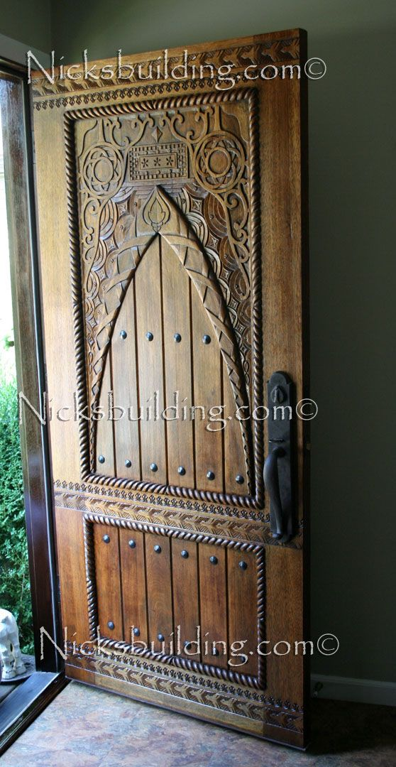 Hand Carved Door - Exterior Carved Door - Wood Carved Entrance Door. Make Your home have a custom touch with this hand carved Front Door. bought at www.nicksbuilding.com