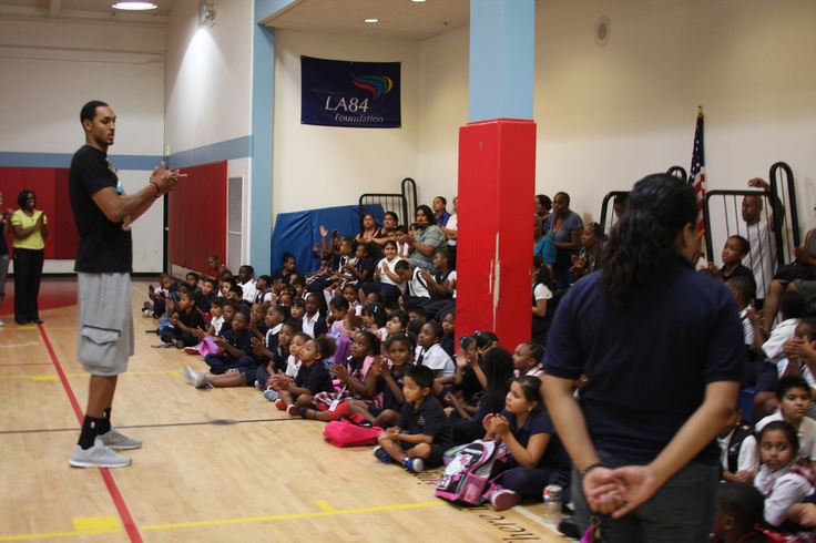 Ryan Hollins encourages the children at The BIG Assist
