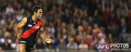 Nathan Lovett-Murray celebrates after a goal during the AFL Round 01 match between the North Melbourne Kangaroos and the Essendon Bombers at Etihad Stadium, Melbourne. (Photo: Andrew