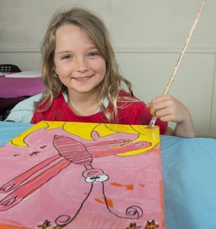 Girl painting a butterfly