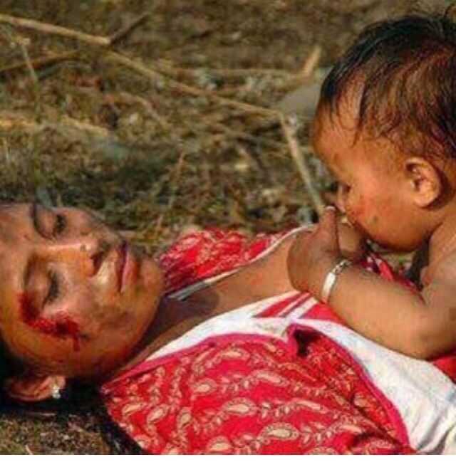 Rojova ~ Burma: a baby feeds from the breast of his/her dead mother!!! What can one say in this situation? Probably nothing, it's better to take action to stop such madness.