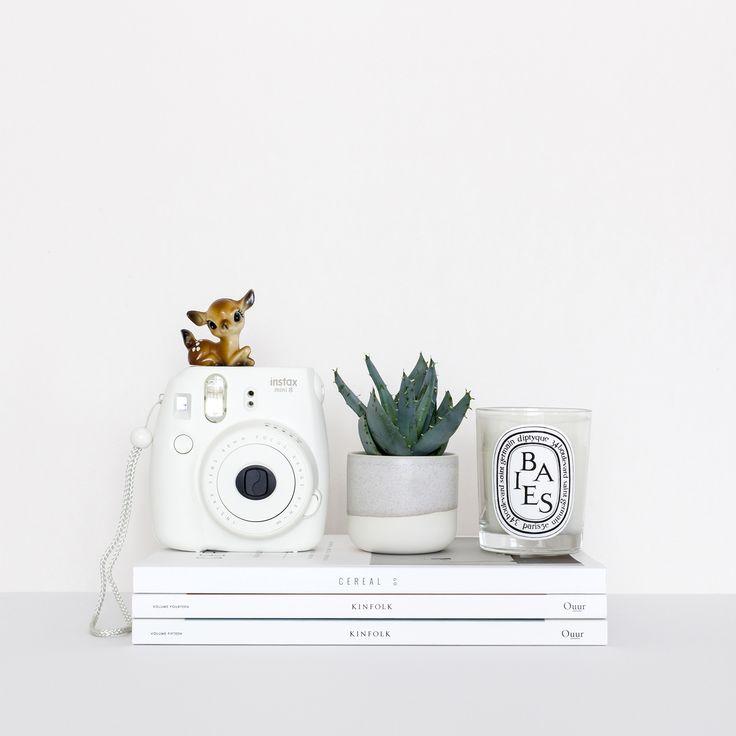 Diptyque candle, Instax camera, Kinfolk magazine, succulent and a kitsch deer
