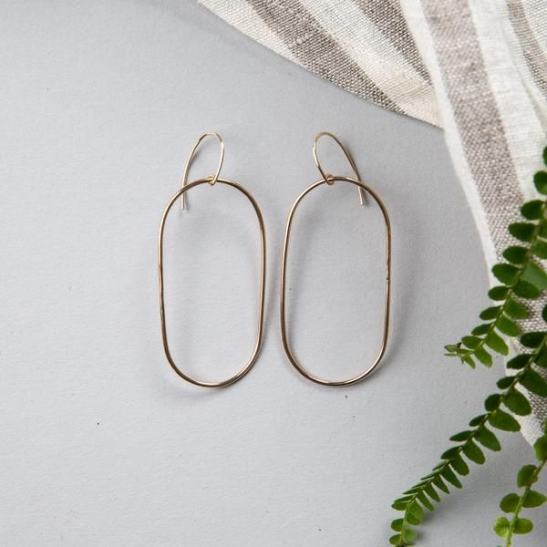 Our Rosa Earrings are simple bronze oval hoop earrings that are handmade in Waco, Texas.      Learn more about Ellen Mote and read the story behind her unique d
