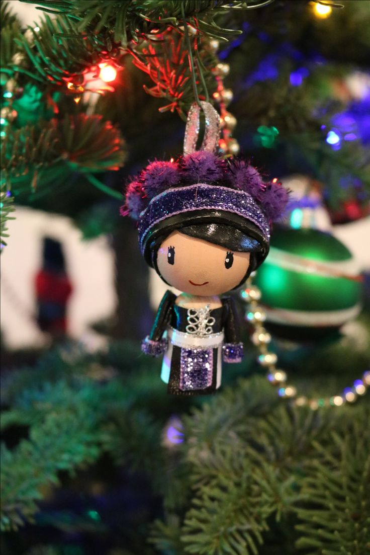 Hmong peg doll made by Rebel Quinn. This doll was made for the Holiday Season.