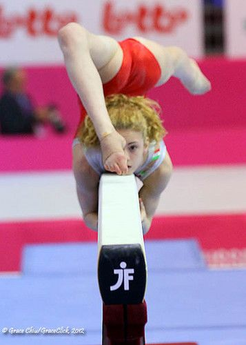 My friend Kiki doing her slow roll over on beam!! ;)  If its not her its her twin..?