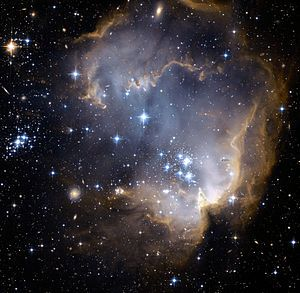 NGC 602, a young, bright open cluster of stars located in the Small Magellanic Cloud (SMC), a satellite galaxy to the Milky Way. See it in DJ Bardon's scene design. *Click on photo to go to the website and learn more!