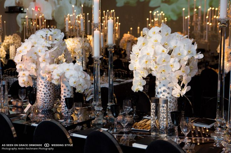 Modern tabletop adorned with black and white design elements featuring phalaenopsis orchids