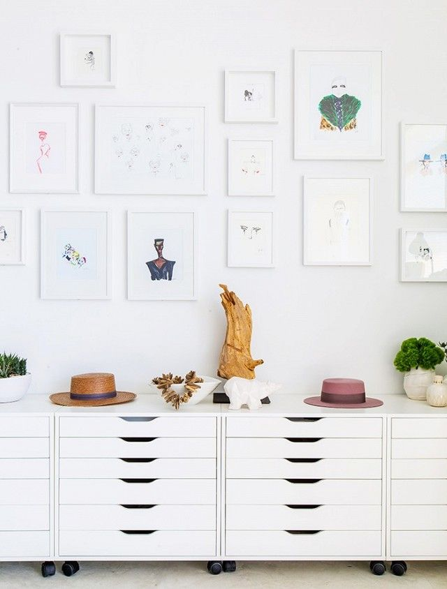 IKEA drawer units lined up next to each other make stylish storage for Kuhn's artwork.