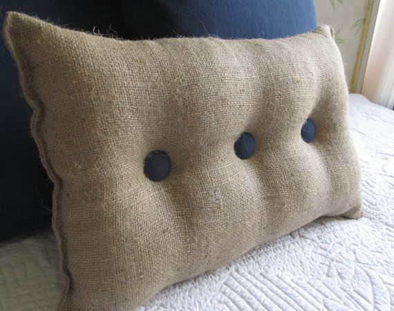 lumbar style 11x19 made of natural burlap this great looking  pillow has organic cotton duck  buttons in a Navy,  polyfilled and stitched close: