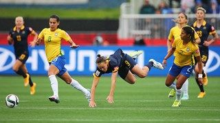 Caitlin Foord of Australia (9) is tripped by Fabiana of Brazil (2)