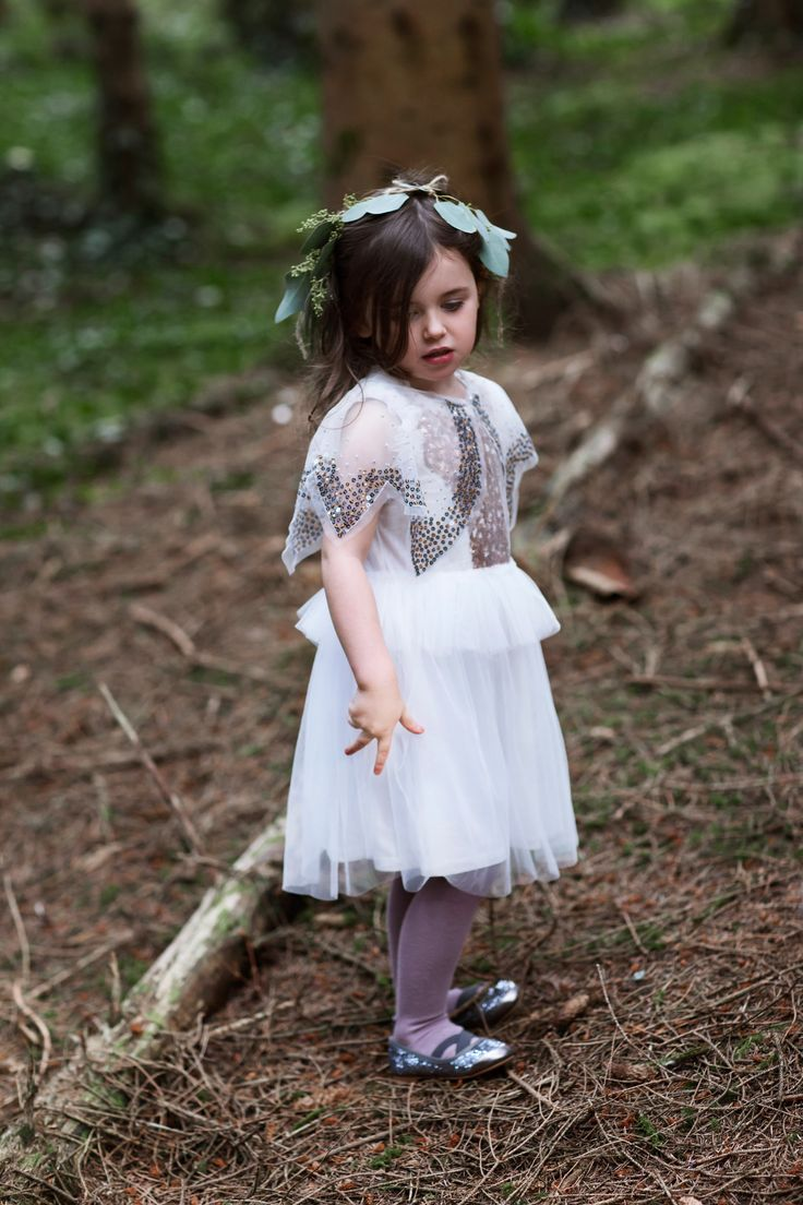 Enchanting white dress worn with mauve tights and sequined shoes, all Leigh Tucker Willow